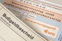 Bußgeldbescheid und Verwarnung mit Zahlungsaufforderung